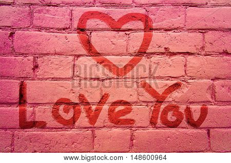 On the wall inscription hand - Love You and drawing a heart