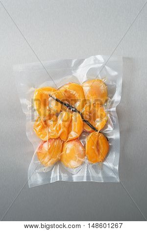 Vacuum sealed fresh apricots with vanilla for sous vide cooking