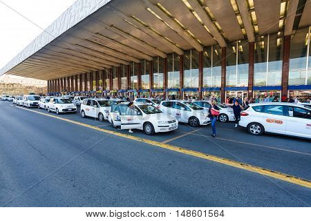 Rome, Italy - September 15, 2016: Taxi near the taxi stop and queue from people at  entrance of Termini Train Station in Rome