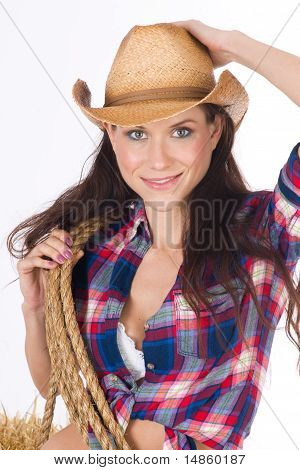 Hat Tip From Attractive Cowgirl Woman Holding Rope on Haybale