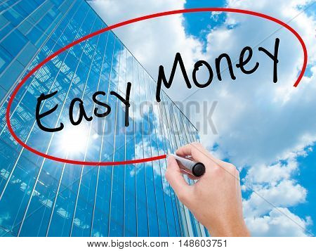 Man Hand Writing Easy Money With Black Marker On Visual Screen