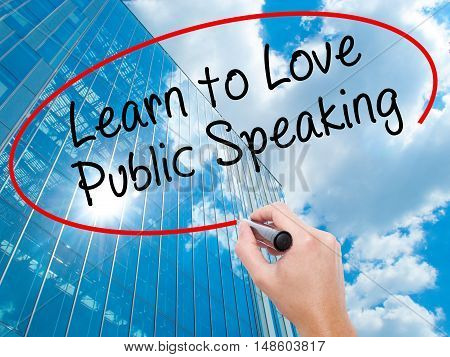 Man Hand Writing Learn To Love Public Speaking With Black Marker On Visual Screen
