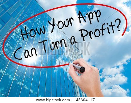 Man Hand Writing How Your App Can Turn A Profit? With Black Marker On Visual Screen