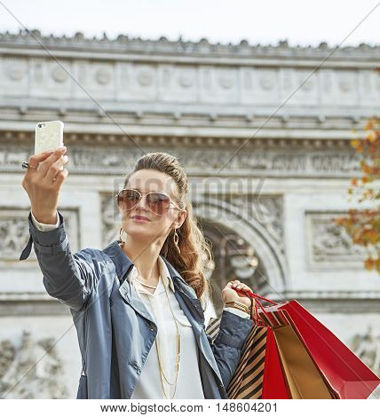 Young Woman Shopper In Paris, France Taking Selfie With Phone