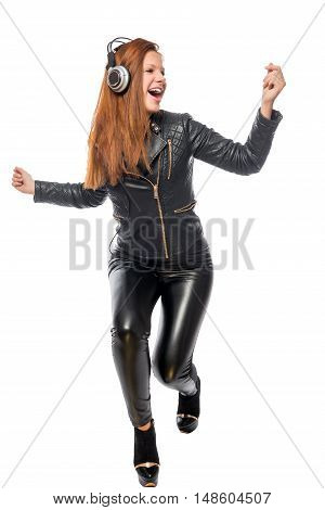 Girl Moves Actively To The Beat On A White Background