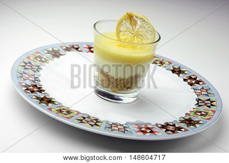 Dessert Cups with Lemon Cheesecake on decorated plate