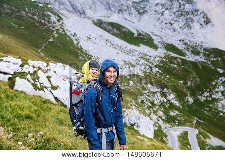 Family On A Trekking Day In The Mountains. Mangart, Julian Alps, National Park, Slovenia, Europe.