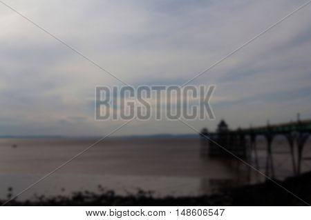 View Of The Seafront At Clevedon, England. Including The Pier. Out Of Focus.