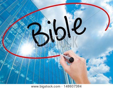 Man Hand Writing Bible With Black Marker On Visual Screen