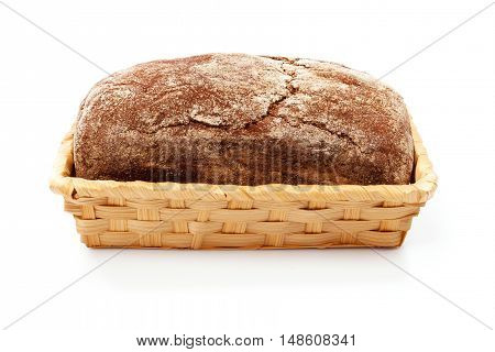Fresh bread in basket, isolated on white background