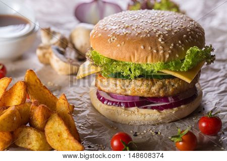 burger with grilled turkey cheese and tomato