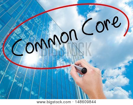 Man Hand Writing Common Core With Black Marker On Visual Screen