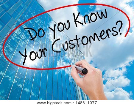 Man Hand Writing Do You Know Your Customers? With Black Marker On Visual Screen