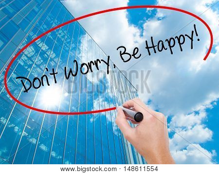 Man Hand Writing Don't Worry, Be Happy! With Black Marker On Visual Screen