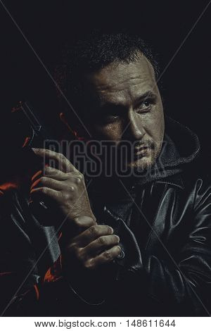 man with a gun ready to shoot