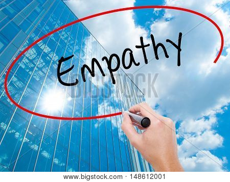 Man Hand Writing Empathy With Black Marker On Visual Screen