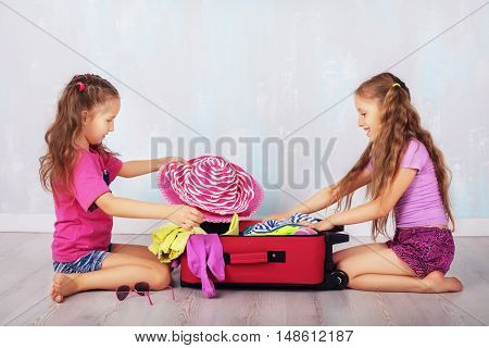 two sisters collect the suitcase on a journey