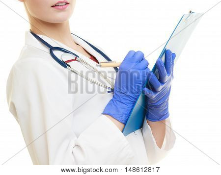 Woman Doctor In Lab Coat With Clipboard And Pen