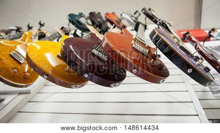 Rome, Italy. September 20Th 2016.  Electric Guitars Hanging In Store