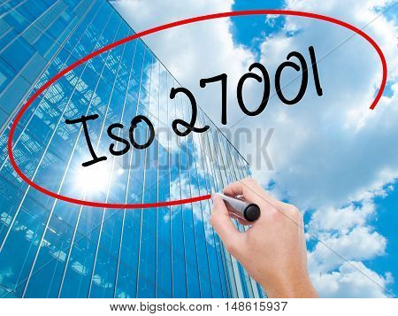 Man Hand Writing Iso 27001  With Black Marker On Visual Screen