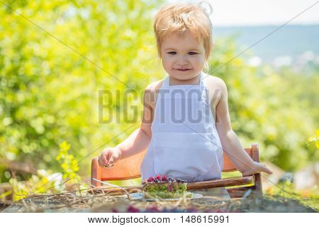 Little Boy In White Pinafore