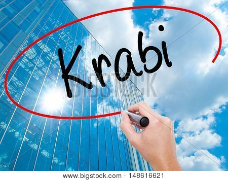 Man Hand Writing Krabi  With Black Marker On Visual Screen.