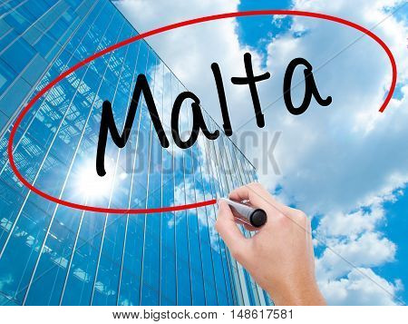 Man Hand Writing Malta With Black Marker On Visual Screen