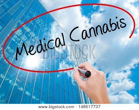 Man Hand Writing Medical Cannabis With Black Marker On Visual Screen
