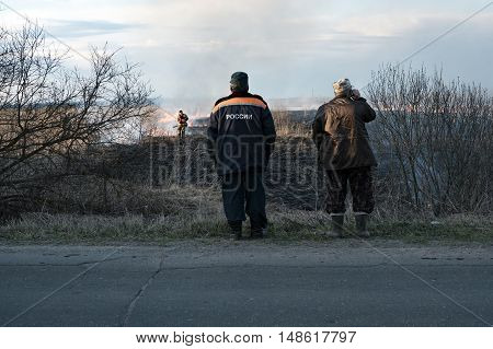 Russia. Fire in the Tver region. Burning dry grass, a large area of ignition. Bigada fire extinguishes