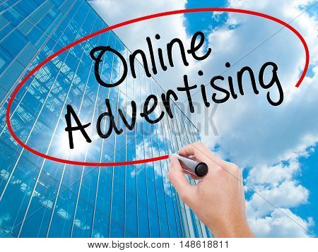 Man Hand Writing Online Advertising With Black Marker On Visual Screen