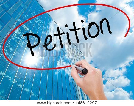 Man Hand Writing Petition With Black Marker On Visual Screen