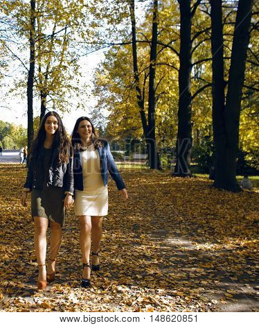 mature real mother with daughter outside autumn fall in park, recreation concept