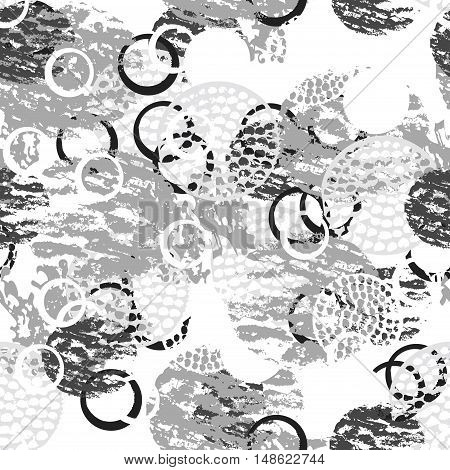 Black and white grunge abstract seamless pattern with circles rings different brush strokes and shapes. Infinity textured circles background. Vector illustration.