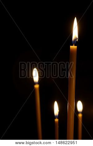 the burning in the dark taper candles