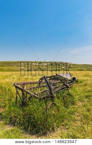 Old farm equipment on a Farmstead in rural Southern Alberta Canada