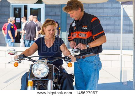 York PA - September 23 2016: A motorcyclist at the annual Harley-Davidson Factory Open House gets instructions from manufacturers staff.
