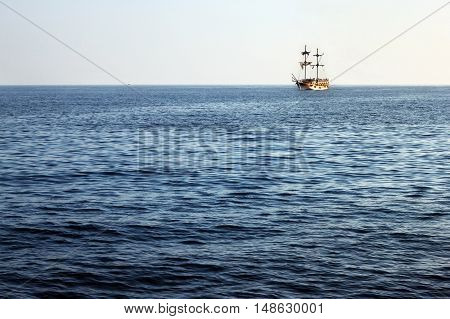 Tourist pirate ship on the horizon of the Mediterranean Sea in Alanya. Turkey.