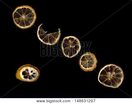 Sun-dried (dried) lemon close-up on a black background