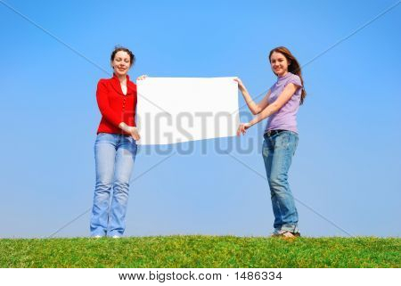 Girls Holding Blank Sheet