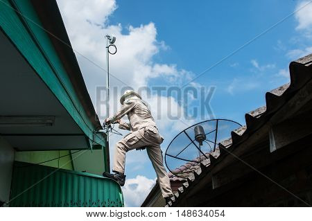 young man working install antenna , install