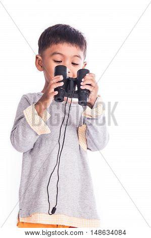 little boy looking through binocular on white background