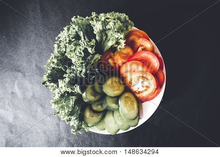 A close up shot of mix vegetables shot on dark background. A view from above.