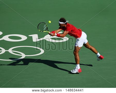 RIO DE JANEIRO, BRAZIL - AUGUST 12, 2016: Olympic champion Rafael Nadal of Spain in action during men's singles quarterfinal of the Rio 2016 Olympic Games at the Olympic Tennis Centre