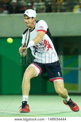 RIO DE JANEIRO, BRAZIL - AUGUST 12, 2016: Olympic champion Andy Murray of Great Britain in action during men's singles final of the Rio 2016 Olympic Games at the Olympic Tennis Centre