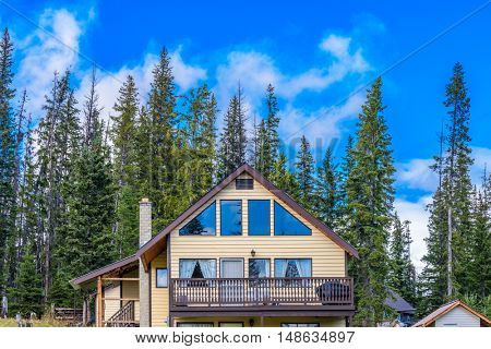 The top of the house or log cabin with nice window.