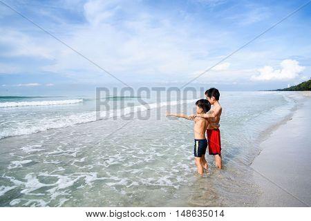 Boys Stand On The Beach