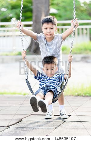 Asian Boy Play With Swinging.