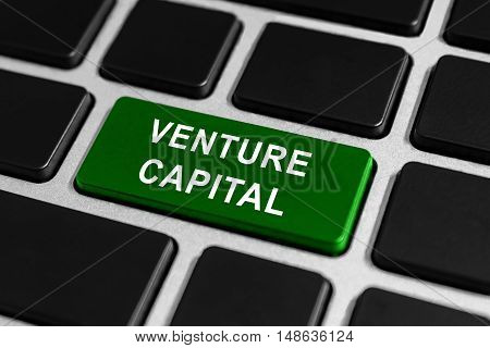 venture capital green button on keyboard business concept