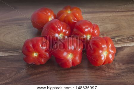 red ripe tomatoes on a wooden table