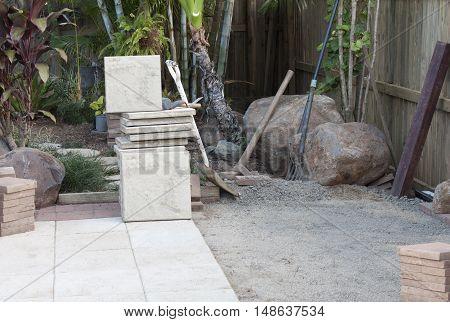 Laying paving bricks around the pool area